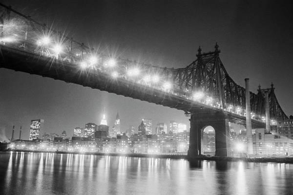 Photograph - Queensboro Bridge And Manhattan At Night by Bettmann