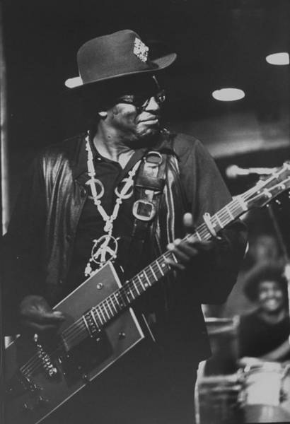Human Interest Photograph - R & B Artist Bo Diddley Playig Guitar by John Olson