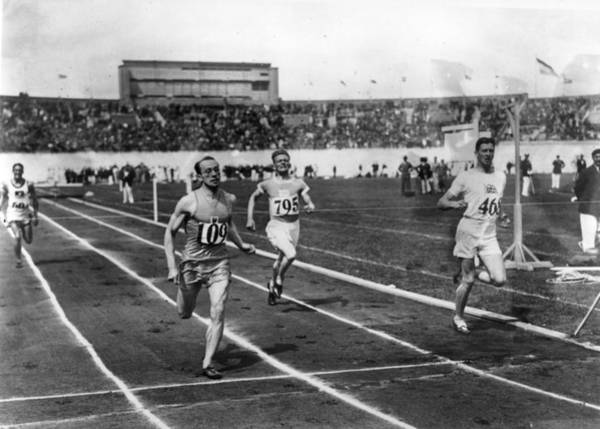 Determination Photograph - Race Finish by Central Press