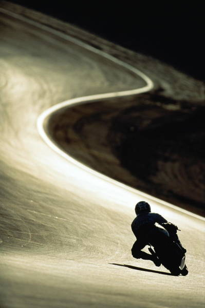 Motorcycle Racing Photograph - Racing Motor Cyclist Silhouetted On by Anton Want