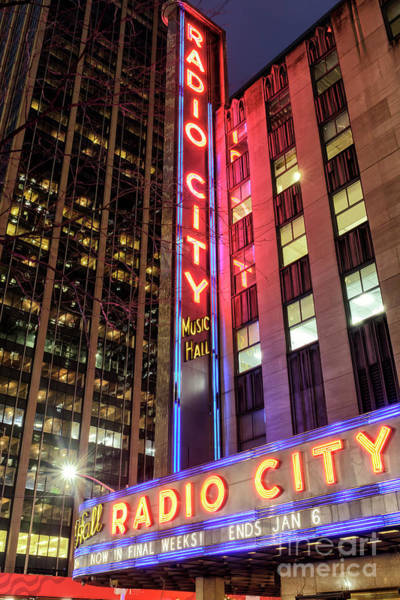 Photograph - Radio City Glow New York City by John Rizzuto