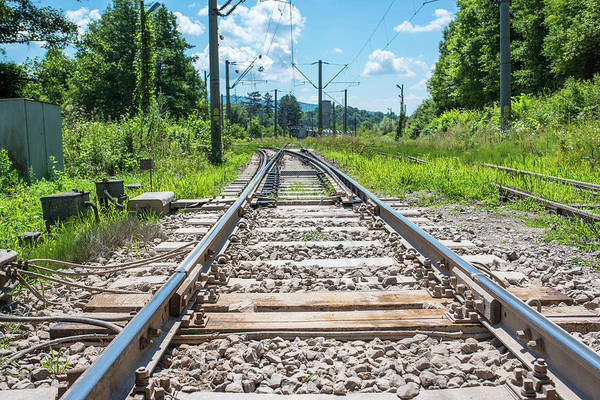 Wall Art - Photograph - Railway In Focus, Old Train In The Background by Benedek Alpar