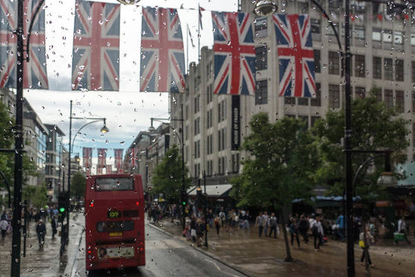 Photograph - Rainy London - Oxford Street Red Double Decker Bus And Union Jacks by Georgia Mizuleva