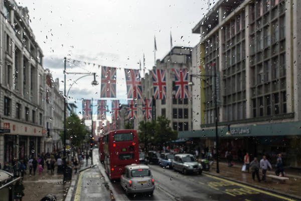 Photograph - Rainy London - Oxford Street Union Jacks by Georgia Mizuleva
