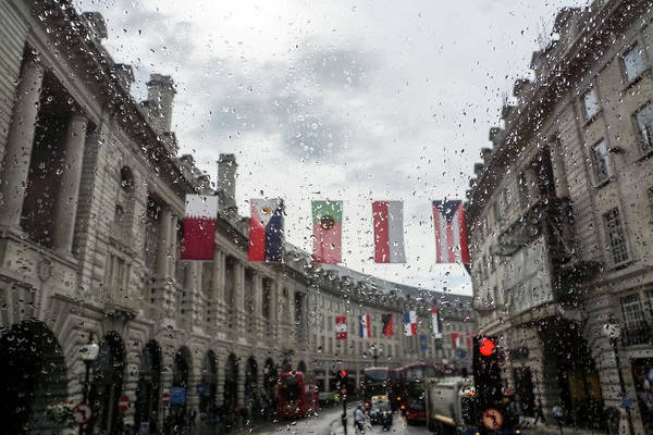 Photograph - Rainy London - Regent Street Multinational Flags by Georgia Mizuleva