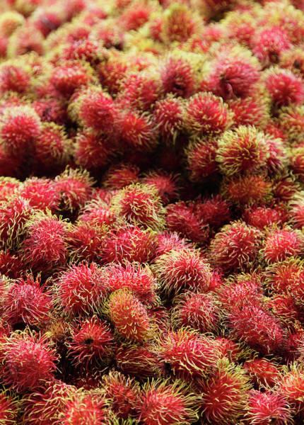 Retail Photograph - Rambutan Fruit In Market by Paul Taylor