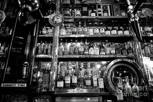 Wall Art - Photograph - range of irish whiskeys in The Long Hall victorian pub one of the oldest pubs in Dublin republic of  by Joe Fox