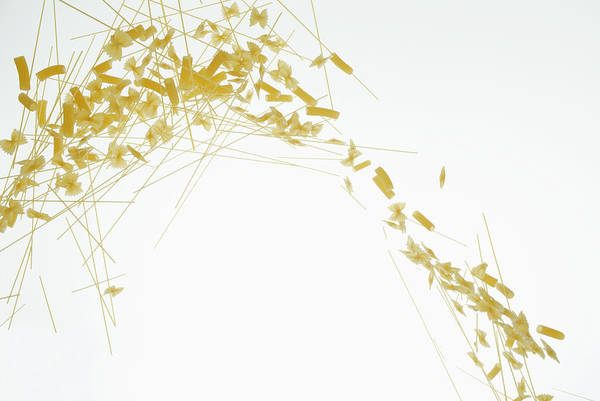 Wall Art - Photograph - Raw Pasta Against A White Background by Dual Dual
