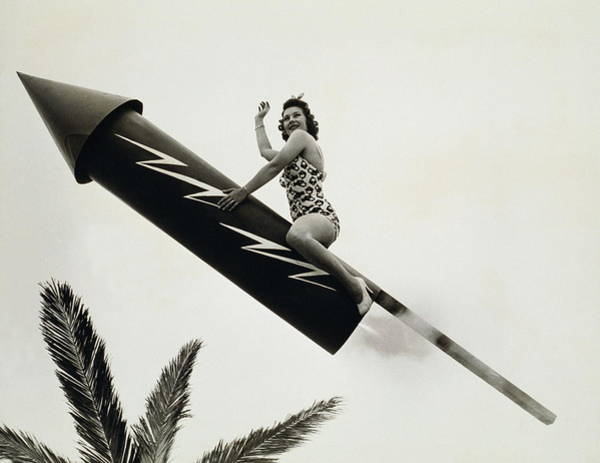 Taking Off Photograph - Real Firecracker, Woman Flies Through by Archive Holdings Inc.
