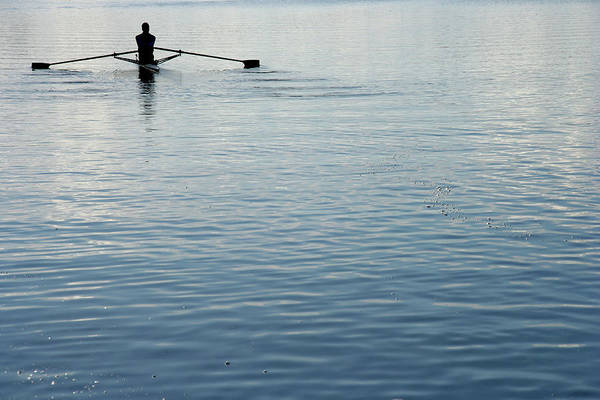 Rowing Wall Art - Photograph - Rear View Of A Man Rowing A Boat by Ggwink