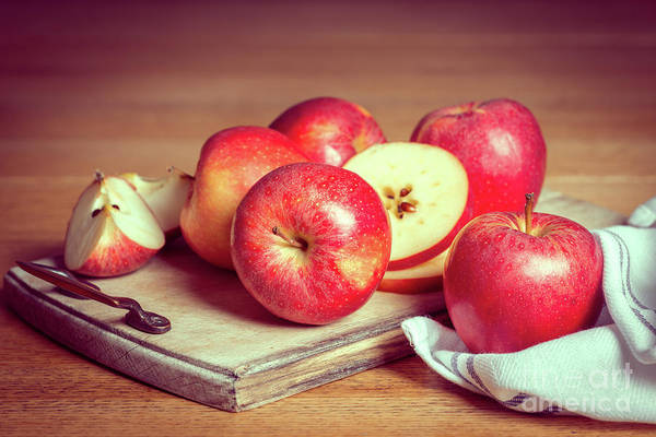 Wall Art - Photograph - Red Apples On Rustic Chopping Board by Amanda Elwell