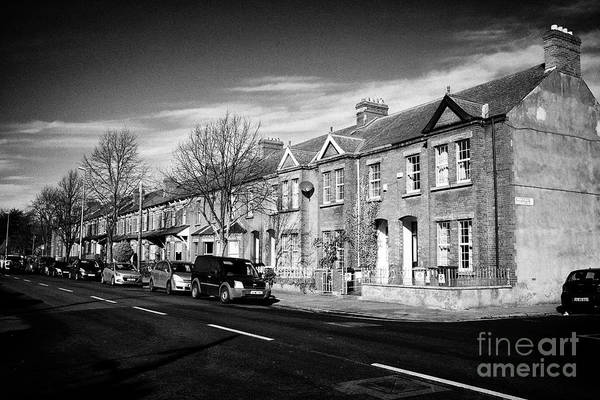 Wall Art - Photograph - red brick houses on the clonliffe road at junction with distillery road dublin 1 Dublin Republic of  by Joe Fox
