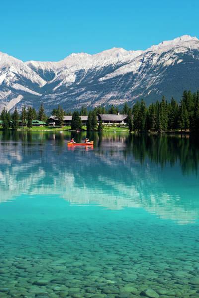 Canoe Photograph - Red Canoe On Lac Beauvert Near Jasper by Emily Riddell