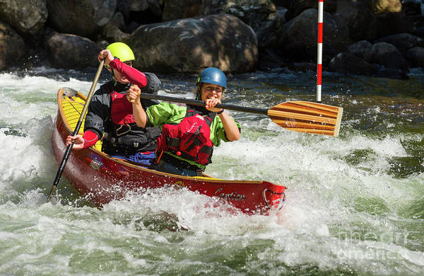 Photograph - Red Canoe Riding The Rapids by Les Palenik