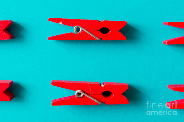 Wall Art - Photograph - Red Clothespins On Cyan Background by Zamurovic Photography