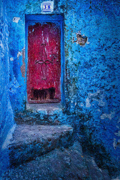 Photograph - Red Door In A Blue Wall - Morocco by Stuart Litoff