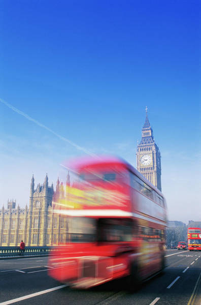 English Culture Photograph - Red Double-decker Bus Driving Past Big by Peter Adams