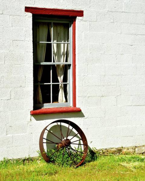Photograph - Red Framed Window And Wagon Wheel by Jerry Sodorff