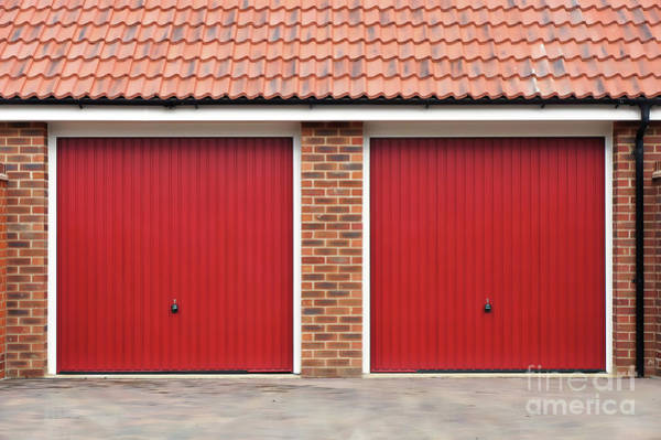 Wall Art - Photograph - Red Garage Doors by Tom Gowanlock