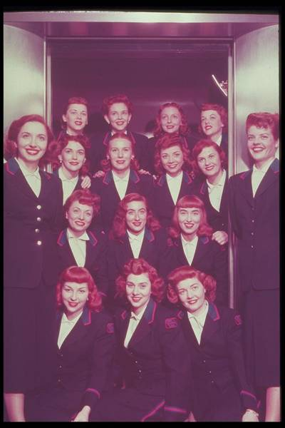Old People Photograph - Red Haired Women In Front Of Elevator by Archive Holdings Inc.