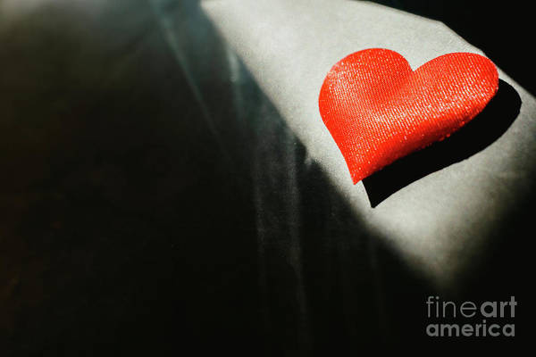 Photograph - Red Hearts Isolated Dark Background Illuminated By A Ray Of Sun To Use In The Background, With A Lot Of Empty Space Copy Space. by Joaquin Corbalan