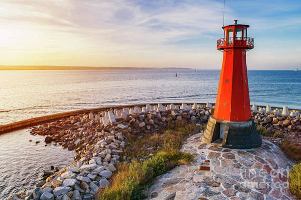 Wall Art - Photograph - Red Lighthouse On The Rocky Seashore. by Michal Bednarek