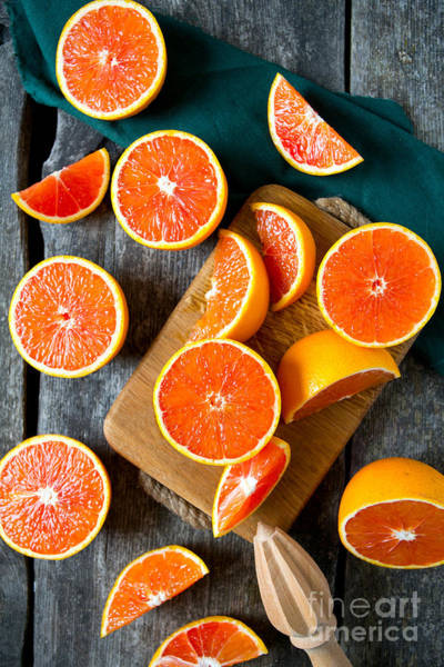 Wall Art - Photograph - Red Oranges On Wooden Surface by Diana Taliun