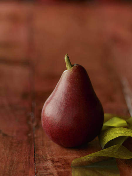 Healthy Eating Photograph - Red Pear With Green Ribbon by Carin Krasner