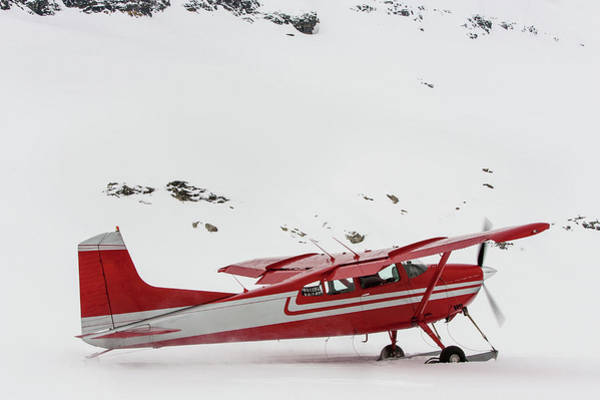 Red Robin Photograph - Red Plane With Skis Taking Off In Snow by Robin Skjoldborg
