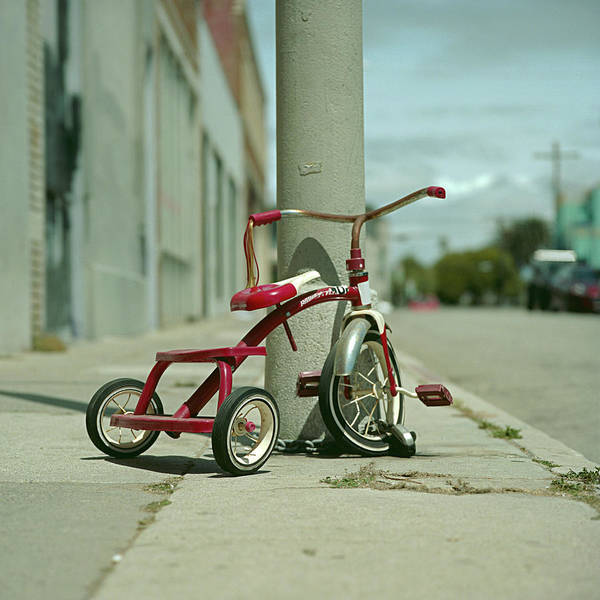 Stationary Photograph - Red Tricycle by Eyetwist / Kevin Balluff