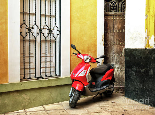 Photograph - Red Vespa In Seville by John Rizzuto