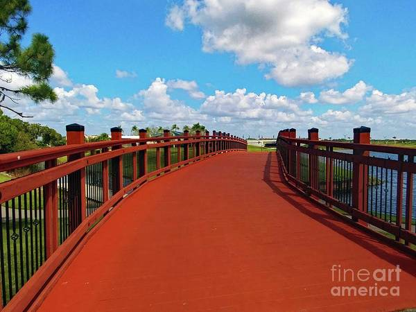 Photograph - Red Wooden Bridge Under A Sunny Blue Sky by Gary Wonning