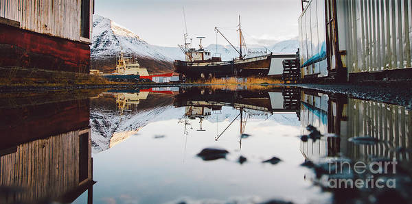 Photograph - Reflection In A Crystalline Puddle Of Aground And Old Boat. by Joaquin Corbalan