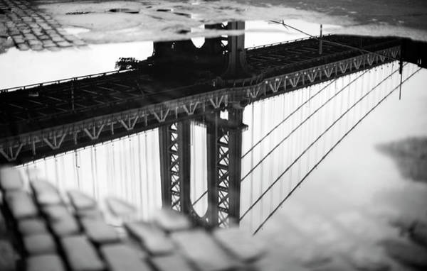 Photograph - Reflection Of Bridge In Puddle by Norman, Morgan