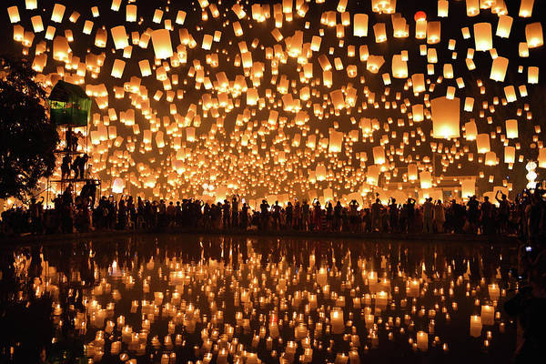 Thai Wall Art - Photograph - Reflection_floating Lanterns  Yi Peng by Nanut Bovorn
