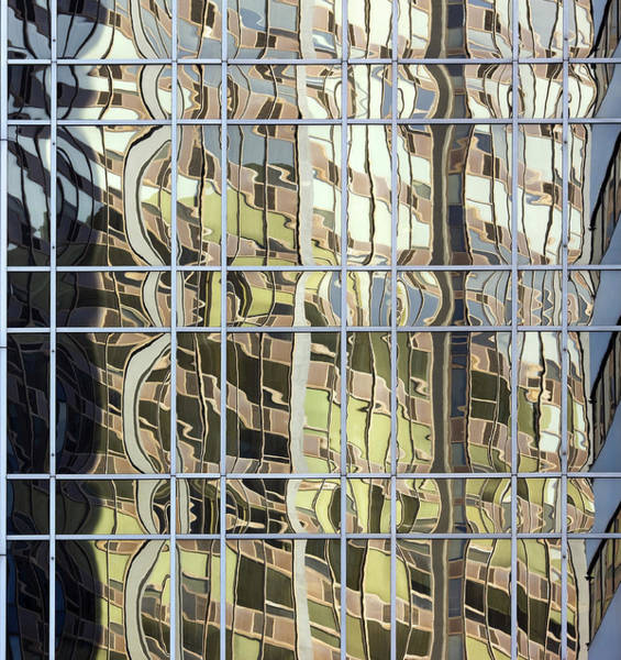 Glass Photograph - Reflections In Mirrored Building Facade by Andy Sotiriou