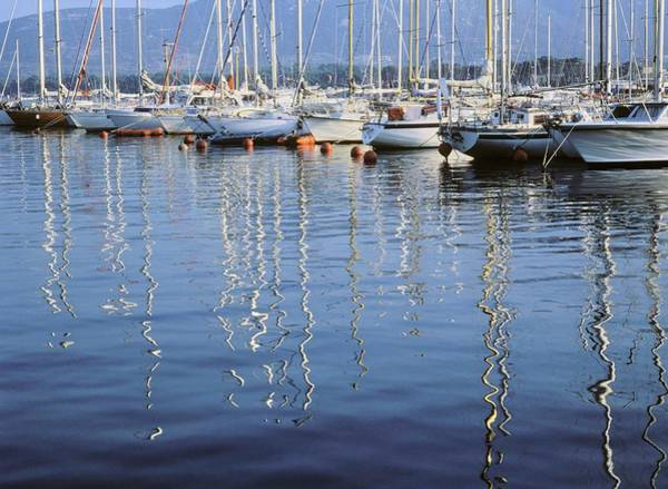 Corsica Photograph - Reflections Of Yachts In Ocean, Calvi by Otto Stadler