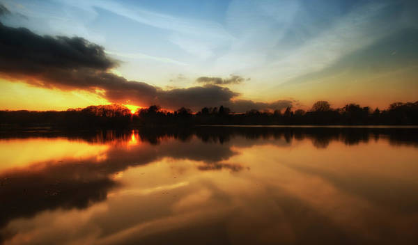 Warwickshire Photograph - Reflective Sunset Over Still Lake Waters by Verity E. Milligan