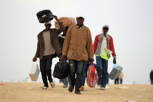 People Walking Photograph - Refugees Cross Tunisian Border To by Dan Kitwood