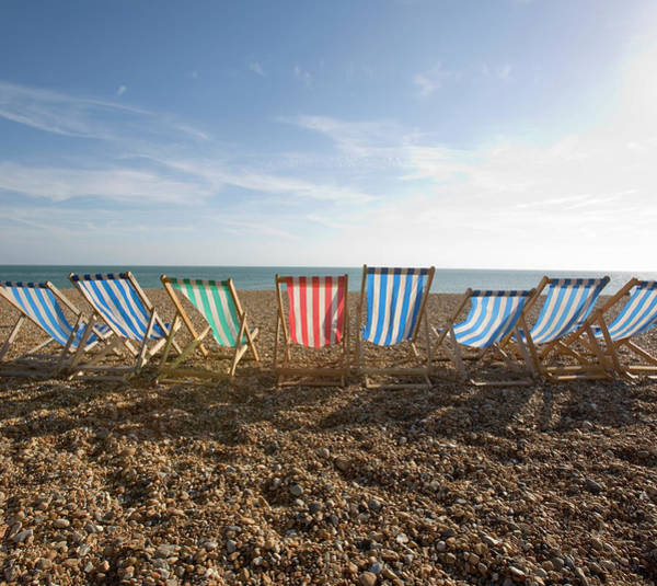Armchair Photograph - Rental Loungers On Beach, Rear View by Grant V. Faint