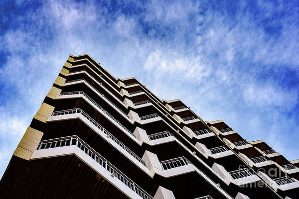 Photograph - Residential Building Of Symmetrical Architectural Patterns With Blue Clouds Background, Real State Concept. by Joaquin Corbalan