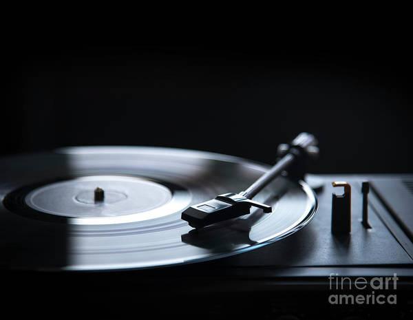 Record Album Wall Art - Photograph - Retro Gramophone Vinyl Player Over Black Background With Copyspa by Jelena Jovanovic
