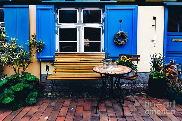 Wall Art - Photograph - Retro Table And Bench Next To The House In The Old Town Of Stralsund by Michal Bednarek