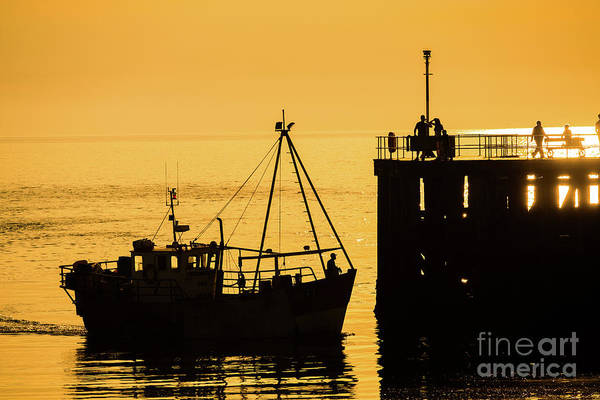 Photograph - Returning To Harbour At Dusk by Keith Morris