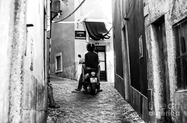 Wall Art - Photograph - Riding In Alfama Lisbon by John Rizzuto