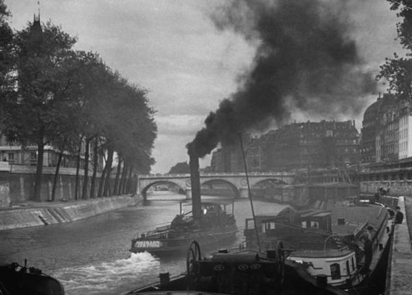 Photograph - River Boat Belching Smoke As It Passes B by Andreas Feininger