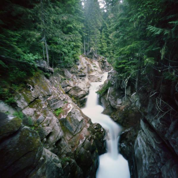 River Flowing Through Lush Canyon Art Print