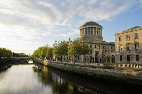 Quayside Photograph - River Liffey And The Four Courts In by Lleerogers