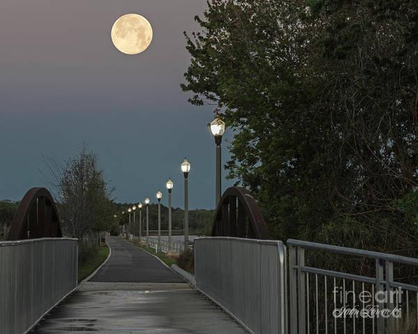 Photograph - River Walk Moon Rise by John Zawacki