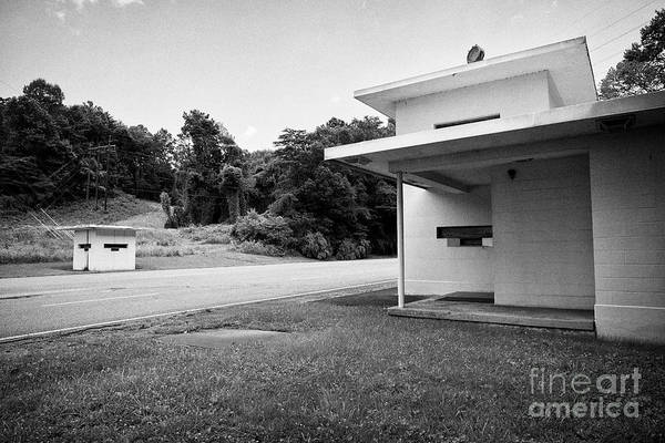 Wall Art - Photograph - road access turnpike gatehouse built as part of the manhattan project in the former secret city of O by Joe Fox